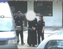 Police puts handcuffs on monks, before the cameras